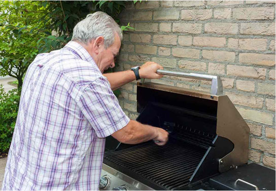 The old man using oven
