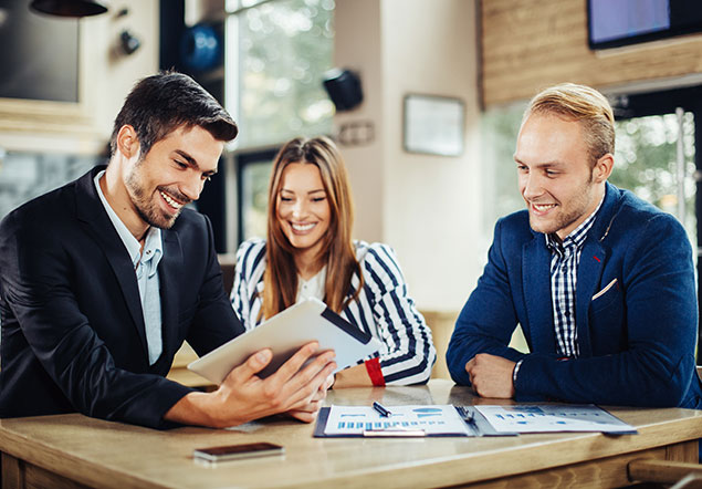 Three people talking business and enjoying with laugh