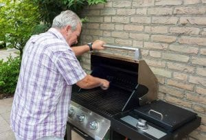 Old Man Using Oven